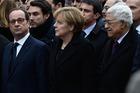 Francois Hollande, Angela Merkel and Mahmoud Abbas walk during a mass unity rally. Photo / AP