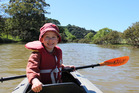 Smiling every dip of the oars, this is one happy young paddler. Photo / Supplied