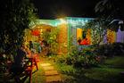 A restaurant in Rarotonga by night. Photo / Tessa Chrisp
