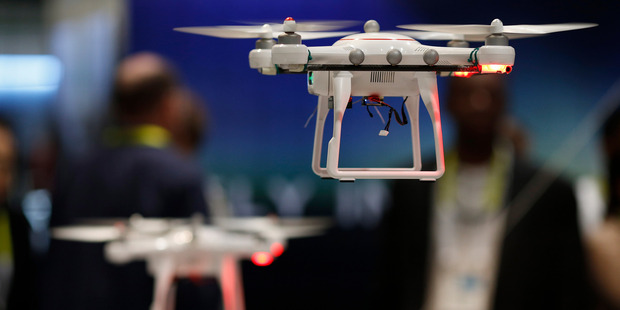 Drones fly at the Autel booth during the International CES. Photo / AP