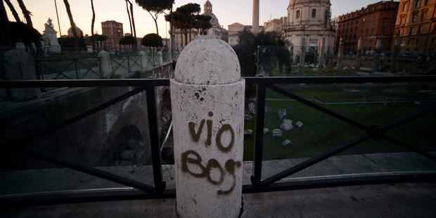 Graffiti on a column in Rome's Trajan forums. Photo / Getty Images