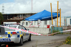 The crime scene at the construction depot on Selwood Rd, Henderson, at which Charanpreet Dhaliwal died of multiple skull fractures. Photo /  Doug Sherring