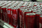 In the first 10 minutes of drinking a can of coke more than 100% of daily sugar intake is consumed. Photo / Getty Images