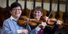 Concertmaster Ryo Terakado (left) and NZ Barok's Miranda Hutton ready their baroque violins. Photo / Nick Reed