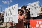 Protestors gather outside Dr. Walter James Palmer's dental office in Bloomington. Photo / Ann Heisenfelt