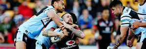 Sam Tomkins is tackled during the round 21 NRL match between the New Zealand Warriors and the Cronulla Sharks at Mt Smart Stadium. Photo / Getty Images