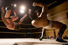 Pro wrestlers Travis Banks, left, and Aaron Henry, right, wrestle at the IPW Impact Pro event, at the the John Locke Theatre, Alfriston College. Photo / Brett Phibbs