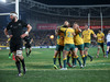 The piucture tells the story. Australian players celebrate Nic White's decisive late try in Sydney. Photo / AP