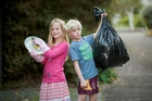 Twins Gemma and Seamus Leathley, 8, earn $8 a week each for doing chores around the home. Photo / Chris Loufte