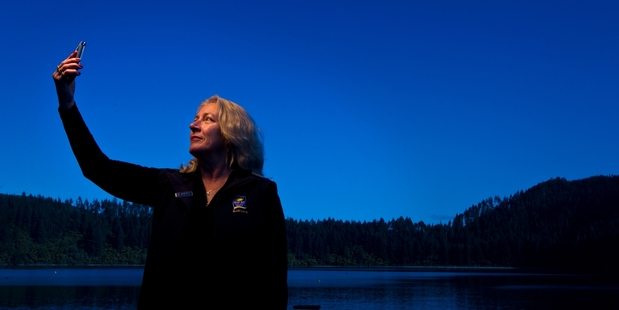SEARCHING FOR SIGNAL: Blue Lake Top 10 Holiday Park owner Sheryl Murray would love there to be cellphone coverage at Tikitapu. PHOTO/STEPHEN PARKER