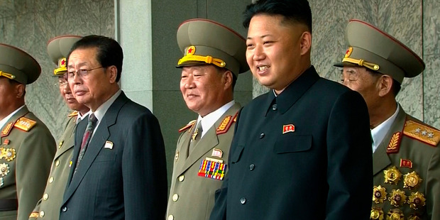 In this image taken from video North Korean leader Kim Jong Un (right) smiles while watching a military parade marking the 65th anniversary of the country's founding. Photo / AP