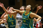 New Zealand Tall Ferns player Penina Davidson (centre) is flanked by Australian Opals player Natalie Burton (left) and Laura Hodges (right) during tonights basketball match. Photo / Alan Gibson