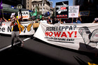 Protesters march down Queen Street in opposition to the government's TPP trade deal talks. Photo / Dean Purcell