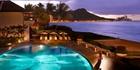Waikiki Beach's historic Halekulani hotel is known for its pool featuring the cattleya orchid motif. Photo / Barbara Kraft