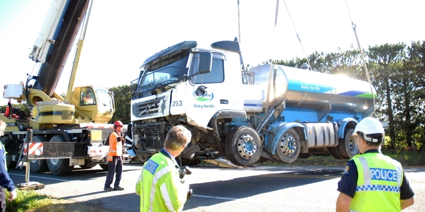 HOIST: A 60-tone crane hoists the crippled tanker from the side of SH2 where the heavy vehicle came to rest after the collision. PHOTO/NATHAN CROMBIE