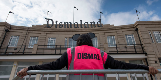 A steward is seen outside Bansky's 'Dismaland' exhibition. Photo / Getty Images