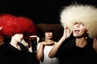 Servilles' Kizzie Amoore, Devon Toi and Asena Yildiz show off their fuzzy wigs backstage. Photo / Nick Reed