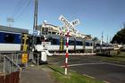 A train crosses the level crossing at Morningside Station, St. Lukes. Photo / Janna Dixon