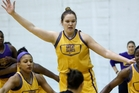 Megan Craig playing defence last year for New York college basketball side the Great Danes. The towering 2.04m player will easily be the tallest player in the transtasman league next year. Photo / AP