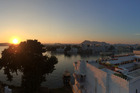 Sunset over the lake at Udaipur. Photo / Andrew Laxon