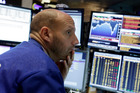 Specialist Meric Greenbaum works at his post on the floor of the New York Stock Exchange. File photo / AP