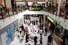 Christmas shoppers at Westfield St Lukes mall - Auckland's growing northwest is one of the least developed for high quality retail space, say developers. Photo / Chris Gorman