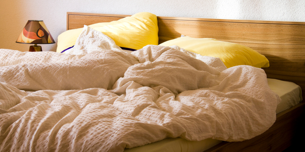 Experts recommend leaving your bed unmade for the entire day. Photo / iStock