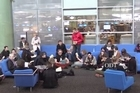 About 35 people sat reading books silently in the University of Otago link building this afternoon, protesting the interim banning of Ted Dawe's book 'Into the River'. Source: ODT/YouTube