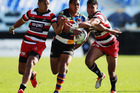 Tevita Li attempts to bust through two tacklers in North Harbour's win over Counties. Photo / Getty