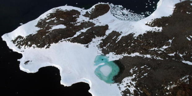 A turquoise lake forms from melting snow near Cape Folger on the Budd Coast, Antarctica. Photo / Getty Images