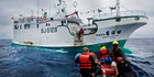 Greenpeace activists prepare to board illegal fishing vessel Shuen De Ching No 888. © Paul Hilton / Greenpeace