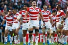 Japan players celebrate their surprise victory during the 2015 Rugby World Cup Pool B match between South Africa and Japan. Photo / Getty Images.