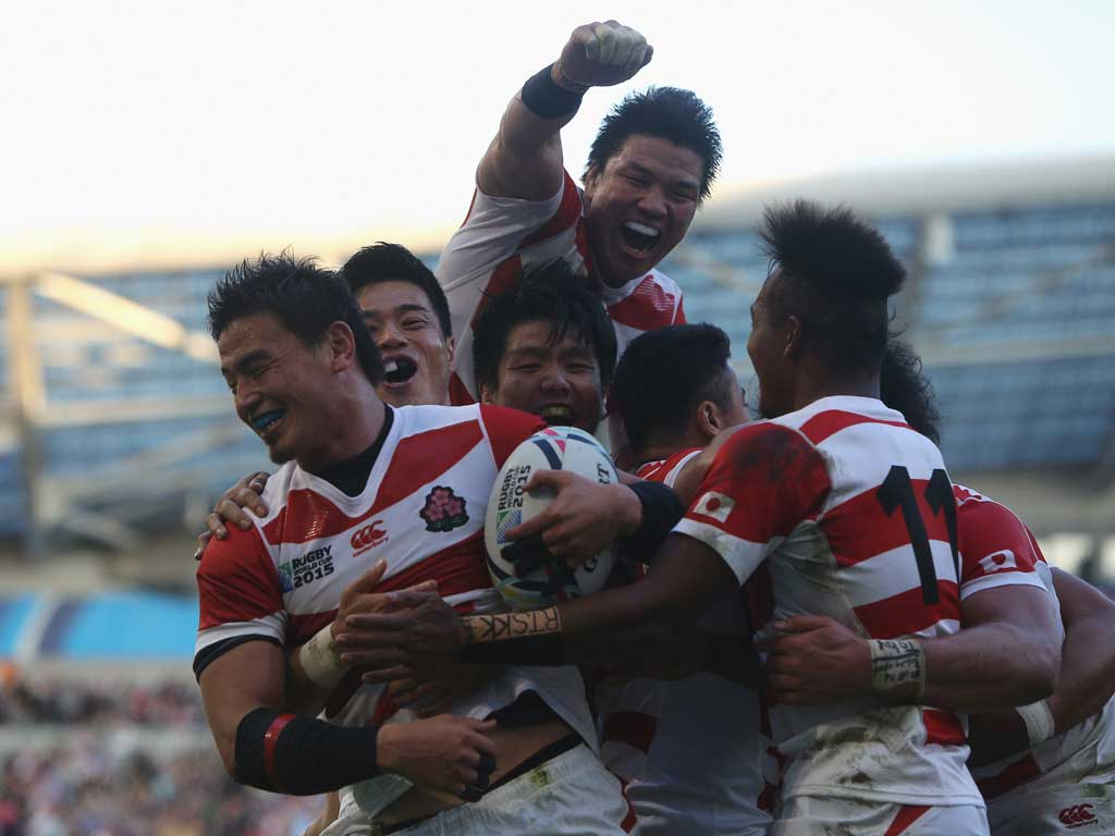 Ayumu Goromaru of Japan celebrates scoring his team's second try during the 2015 Rugby World Cup Pool B match between South Africa and Japan. Photo / Getty Images.