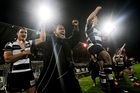 The Magpies releasing the pressure valve to welcome the final whistle. Photo / Paul Taylor