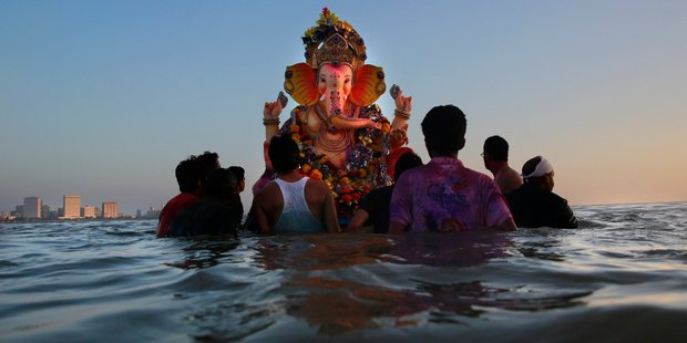 Indians in Mumbai prepare to immerse a statue of Ganesha in the Arabian Sea. Photo / AP