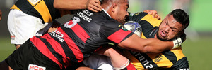 Hika Elliot is tackled by Nepo Laulala during Taranaki's win over Canterbury. Photo / Getty
