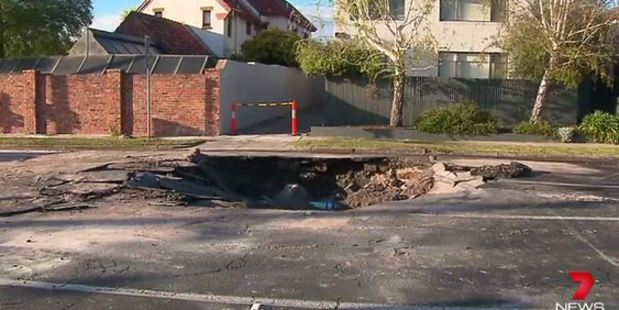 A burst water main opened up a sinkhole in the middle of a busy Melbourne road. Photo / Seven News