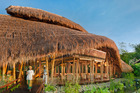 The Sakti Dining Room at Fivelements Healing Center. The soaring roofline, sculpted from bamboo and thatch, resembles a banana leaf, symbol of nourishment. Photo / Supplied