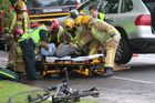 Fire crews used special heavy-lifting gear to free the man from under the vehicle. Photo / Daniel Hines