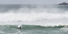 A surfer takes advantage of waves whipped up by wind  at St Clair Beach in Dunedin. Photo / Otago Daily Times