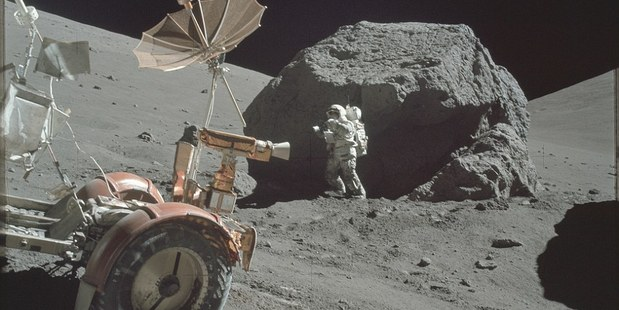 Astronauts collecting samples from huge boulders. Photo / NASA/Flickr