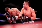 Joseph Parker unleashes in his win over Kali Meehan. Photo/Dean Purcell NZ Herald