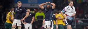 Referee Craig Joubert (right) makes a quick exit after Scotland's last-minute loss to Australia. Photo / AP
