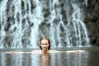 Taking a dip at the foot of Karekare Falls, Waitakere. Photo: Getty Images