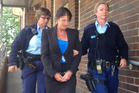 Betty Colt is led out of Moss Vale Local Court on Monday November 3, 2014. Photo / AAP / Ava Benny Morrison
