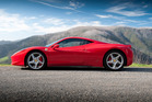 The Ferrari 458 - a seductress with flawless curves, bright red lipstick and a tan leather interior. Photo / Supplied