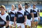 The Auckland Rugby team walks off the pitch after their warm up. Photo / Nick Reed