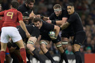 New Zealand All Blacks captain Richie McCaw, Kieran Read and Aaron Smith in action during the Quarter Final. Photo / Brett Phibbs