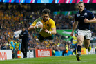 Australia's Adam Ashley-Cooper scores a try during the Rugby World Cup quarterfinal match between Australia and Scotland at Twickenham Stadium. Photo / AP