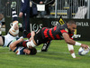 Patrick Osborne dives over to score in the tackle of Simon Hickey. Photo / Getty